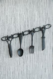 Plastic kitchen tools hanging on wall Royalty Free Stock Photo