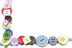 Plastic knappar arkivfoton