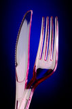 Plastic knife and fork Royalty Free Stock Images