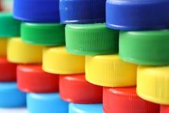 Plastic kroonkurken Stock Foto