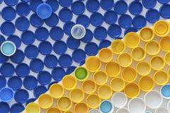 Plastic kroonkurken Stock Foto's