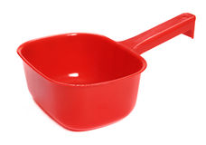Plastic ladle of red Royalty Free Stock Photography