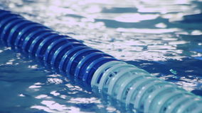 Plastic lanes in swimming pool. Blue lanes of competition swimming pool. Plastic lanes in swimming pool. Closeup of blue lanes of competition swimming pool. Blue stock video footage