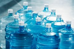 Plastic large blue water bottles. On floor Royalty Free Stock Photography