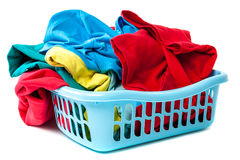 Plastic laundry basket with clothes. Royalty Free Stock Photo