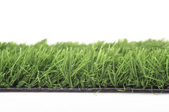 Plastic lawn. On a white background Stock Images