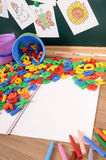 Plastic letters of alphabet on school desk, open book, copy space Stock Image