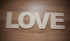 Plastic letters love on wooden background Stock Images