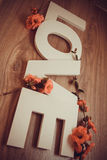 Plastic letters love on wooden background Royalty Free Stock Photos