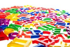 Plastic letters and numbers isolated macro Stock Photos