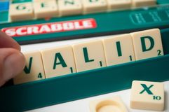 Free Plastic Letters On Scrabble Board Game Forming The Word : Valid Stock Images - 160836044