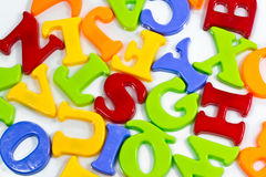 Plastic letters scattered Royalty Free Stock Images
