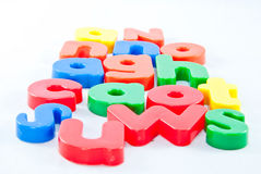 Plastic letters on white background Royalty Free Stock Photo
