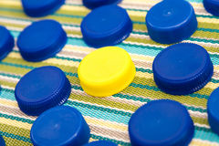 Plastic lids, one in a different color Royalty Free Stock Images