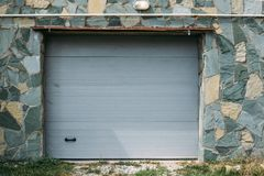 Plastic lift gate of garage in residential house Stock Image
