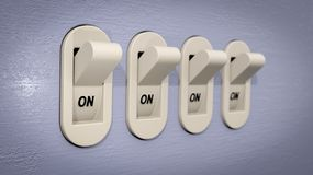 Plastic Light Switches in the ON position Royalty Free Stock Photos