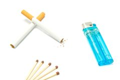 Plastic lighter, two cigarettes and matches Stock Image