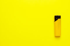 Plastic lighter on yellow background Stock Photo