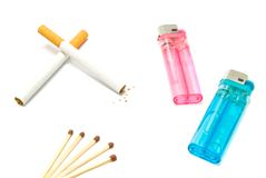 Plastic lighters, two cigarettes and matches Royalty Free Stock Photo