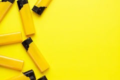 Plastic lighters on yellow background Stock Image