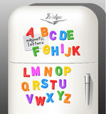 Plastic magnetic alphabet letters displayed on vintage refrigerator. Child`s plastic magnetic alphabet letters displayed on vintage refrigerator. Use as font or royalty free illustration