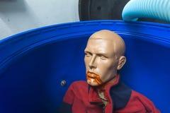 Plastic man in the bin Royalty Free Stock Image