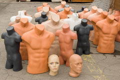 Plastic manikins. Various plastic mannequins arranged on the ground stock image