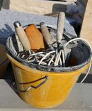Masonry bucket with tools for house construction. Plastic masonry bucket with tools for house construction Stock Photography