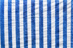 Plastic material in white and blue stripes Royalty Free Stock Image