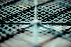 Plastic mesh, texture of black geometrical surface with depth of field. Abstract horizontal background stock image