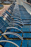 Plastic and Metal Lounge Chairs. Row of blue chaise lounges on the deck of a cruise ship Royalty Free Stock Image