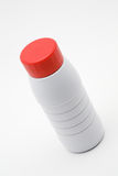 Plastic milk bottle with a red cap. On a white background royalty free stock photo