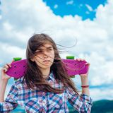 Plastic mini cruiser board. Spring. skateboard sport hobby. Summer activity. ready to ride on the street. Urban scene. City life. Hipster girl with penny board stock photo