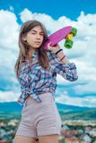 Plastic mini cruiser board. Spring. Urban scene, city life. skateboard sport hobby. Summer activity. ready to ride on. The street. Hipster girl with penny board royalty free stock photos