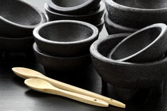 Plastic molcajetes and wood spoons Stock Photography