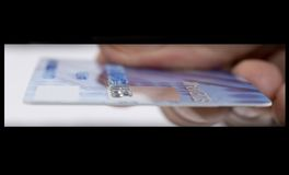 Plastic Money. A view from inside the ATM machine.....using the plastic royalty free stock images