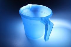 Plastic mug. An empty transparent blue plastic mug Stock Image