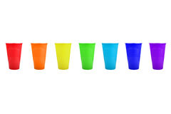 Plastic mug. The rainbows placed on colour on a white background Royalty Free Stock Image