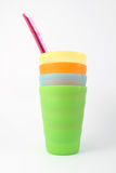 Plastic mugs with straws Royalty Free Stock Images