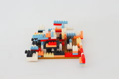 Plastic multi-colored jigsaw puzzle assembled. Stock Photo
