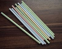 Free Plastic Multi Coloured Drinking Straws On A Flat Surface. Stock Photography - 114794312