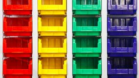 Plastic multicolored box containers on the modern warehouse for piece small storage of goods royalty free stock images