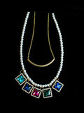 Plastic multicolored necklace. On a black background Royalty Free Stock Images