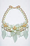 Plastic necklace. beige flower Stock Photo