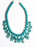 Plastic necklace blue. On a white background Stock Photography