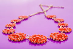 Plastic necklace. five beige flower Stock Photography