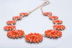 Plastic necklace. five beige flower Stock Images