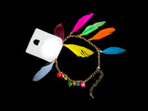 Plastic necklace. multicolored. Decoration bracelet jewelry multicolored plastic stones and feathers black background Royalty Free Stock Photography