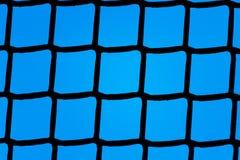 Plastic net backlit tegen een blauwe achtergrond Royalty-vrije Stock Foto's