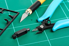 Plastic nippers. Closeup blue plastic nippers on cutting mat Stock Photo